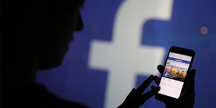 Facebook prueba un boton para compatir con WhatsApp